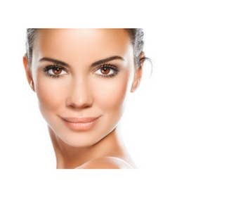 Close-up, beauty portrait of a smiling, beautiful brunette woman; glowing skin; radiance; skin care; facial; serum; boost